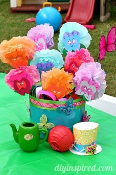 Alice in Wonderland Flowers, a fun and whimsical centerpiece using recycled coffee filters and plastic containers