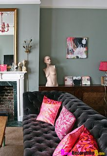 velvet grey sofa.... pay close attention to the creepy mannequin