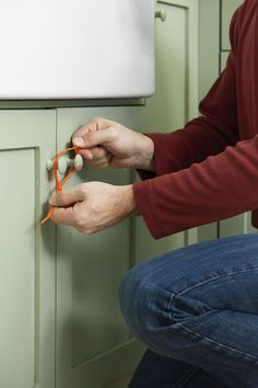 Use zip ties to childproof cabinets. Keep little ones out of off-limits storage by connecting cabinet knobs with a zip tie secured in a loop.