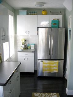 Youngstown kitchen cabinets with hardwood floors and stainless steel appliances
