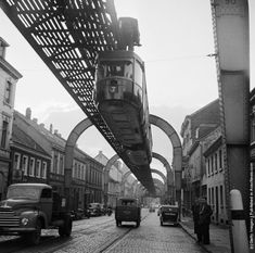 1956: A hanging monorail train moves along the seven mile Wuppertal Monorail System in Germany.