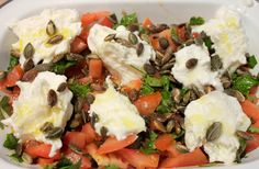 Tomato and caper salad with fresh buffalo mozzarella and a drizzle of extra virgin olive oil. The perfect Italian side