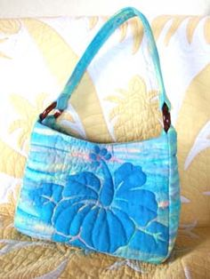 I like the hibiscus but not on the purse. It would be a great pattern for a Hawaiian applique top.