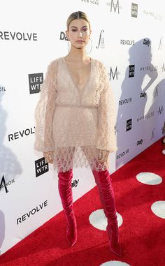 Hailey Baldwin from Fashion Los Angeles Awards 2017: Red Carpet Arrivals  The catwalk queen opts for a textured mini dress paired with fierce, thigh-high boots.