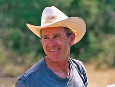 At Home With Presidential Families - Traditional Home® President George W. Bush, 2001-2009 President Bush exudes his down-home style while clearing brush at Prairie Chapel Ranch in Crawford, Texas, in August 2005.  Photograph courtesy of the George W. Bush Presidential Library and Museum