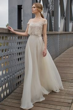 Two pieces wedding set. A romantic illusion off-the-shoulder beaded lace cropped top with a full, flowing silk organza skirt. From Limor Rosen's Urban Dreams Collection.