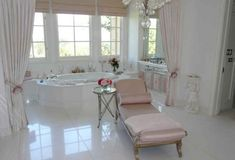 Everything in the master bedroom and bath is white and pale pink, including the cabinets. Lisa Vanderplumps home