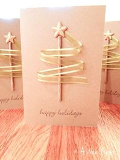 For this card craft, you'll need long ribbon strips, a stick and a star. Glue the stick to the card and around it glue the ribbon in such a way that it appears like Christmas tree. Christmas Card Craft Idea #Christmas #Parenting PARENTING HEALTHY BABIES