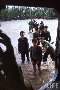 Vietnamese villagers, suspected of being Vietcong or at least collaborating with them are loaded onto a helicopter in the Mekong Delta - Vietnam War