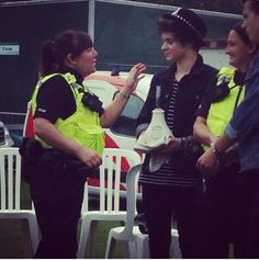 Brad's enjoying wearing that police hat while holding his steam pot. lol
