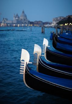 Docked gondolas line up near Piazza San Marco in Venice, Italy, at dawn. Today…