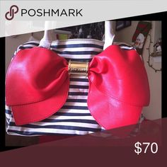 Betsey Johnson Handbag Navy blue and cream colored striped bag with giant red bow on the front Betsey Johnson Bags Shoulder Bags