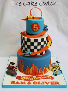 Hi! This cake was made for my sons birthday this weekend. Edible cars with a suspended track spiralling around