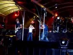 Ava Sambora dancing with Jon Bon Jovi on stage
