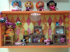Display box for Lalaloopsy - Made with:  the raw materials...    wooden storage box, pieces of wood, pegs, furniture leg covers, sponges and mini LED lights ...    plus materials I have on hand like toothpicks, buttons, beads, fabric, ribbons, scrapbook papers, paints  Scrappalific