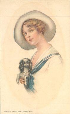 pretty girl in sailor suit cuddling small spaniel