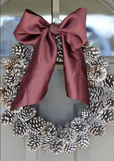 DIY: Pinecone Wreath (Practically FREE).   I'm so making this for home this year I have hundreds of pine cones outside in my yard might as well use them lol !