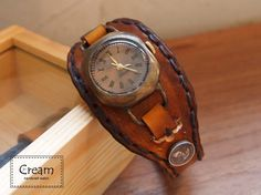 Hey, I found this really awesome Etsy listing at http://www.etsy.com/listing/70473339/vintage-watch-handstitch-leather-band