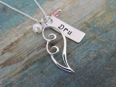 Sterling silver personalized angel wing necklace - custom handstamped name bar, crystal birthstone, pearl - memorial jewelry. $42.00, via Etsy.