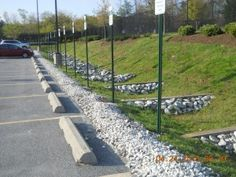 A grass swale with check dams. Photo courtesy Stormwater Maintenance and Consulting, LLC.