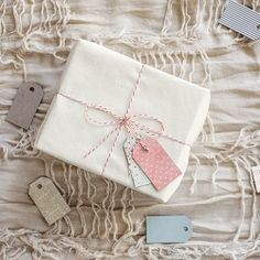 Cereal box gift tags. Mod Podge & paper or fabric. You can use them for more than just wrapping!