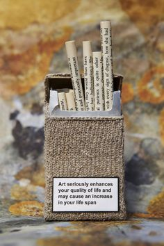 A visual colloquialism. The colloqualism for cigarett in Britain is 'fag'. This Freudian art depictis colloqualism by having the cigaretts made of paper with writing on them. This showcases a literary device at play.