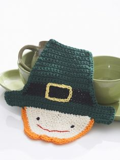Free Pattern - Adorable Leprechaun dishcloth fills your house with cheer. Shown in Lily Sugar 'n Cream.