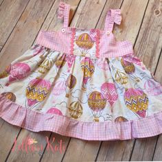 A personal favorite from my Etsy shop https://www.etsy.com/listing/230181913/baby-hot-air-balloon-tunic-ruffle-top