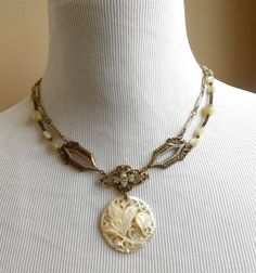 Mother of Pearl Damascene Rhinestone Necklace, Assemblage, Vintage Repurposed, Rosary, Gold Filled Watch Fob by Vinchique on Etsy https://www.etsy.com/listing/151077499/mother-of-pearl-damascene-rhinestone