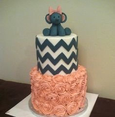 Cute pink and gray elephant baby shower cake with chevron and buttercream roses by @sugarchicccakes