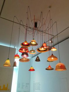 Cluster of lamps made from recycled plastic. Design Museum, London UK