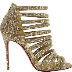 I don't know about you gurls, but this shoe just makes me want to go dancing!  Louboutin lizard sandal