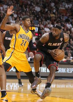 Miami Heat forward LeBron James drives against Indiana Pacer forward Paul George during the first quarter on 3/10/2013.