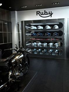 Our favorite helmet designers Les Ateliers Ruby just opened their first boutique, The company has collaborated with many well knwon designers such as Karl Showroom Interior Design, Retail Interior, Showroom Ideas, Motorcycle Store, Motorcycle Workshop, Motorcycle Helmets, Architecture Design, Vintage Interiors, Garage Design