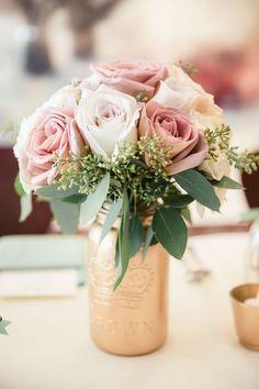 Wedding centerpiece idea: spray paint gold bottles and fill with florals @weddingchicks