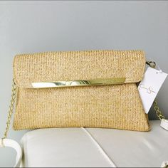 1 DAY SALE!!Stylish Jessica Simpson Purse Stylish and unique. This purse has a natural color straw body with a gold and white strap.one out pocket and wallet style pockets inside. Jessica Simpson Bags