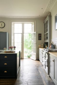 French door leading to patio in English Country kitchen by deVOL