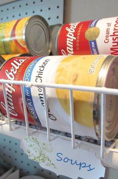 Organize canned food with these wire baskets from the dollar store, fits large and small cans!