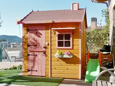 Casita infantil de madera color miel modelo Cabaña.