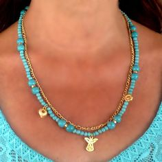 Turquoise Necklace with gold plated charms and angel by CharmByIA, $30.00
