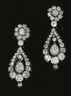 PAIR OF DIAMOND PENDENT EARRINGS, LAST QUARTER OF THE 19TH CENTURY    The surmount of flower head cluster design suspending a pear-shaped diamond swing centre within a graduated surround, set with pear-, cushion-shaped and circular-cut diamonds, mounted in silver and gold