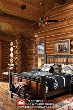 Handcrafted Log Home Master Bedroom. I love the way the inside of the log walls have been done.