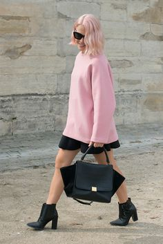 Pepto-Bismol pink never looked as chic as when teamed with a Céline Trapeze bag and booties