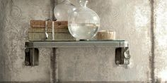Silvery wallpaper with a mottled, oxidised look brings light and glamour into any space. Use it in an entrance hall, dining room or a downstairs cloakroom to make an instant impression.