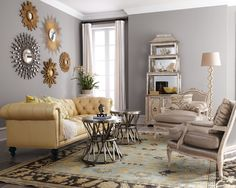 Mirror collection over amazing sofa, against lovely wall color.
