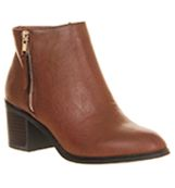 Ankle Boots By OFFICE.  Casual Chelsea boot by OFFICE in tan with contrasting silver zip and block heel.