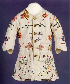 Waistcoat, possibly made by Elizabeth Brainerd Eddy or a member of the Eddy family, East Middletown, Conn., circa 1756–60. Crewel yarn stitched on plain-weave linen, brass buttons.  Eighteenth Century children's clothing is rare, as is the application of crewel embroidery to clothing, which is possibly a regional Connecticut preference.