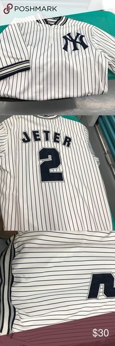 Zipper Derek Jeter Shirt 3/4 zipper Derek Jeter Jersey. Short banded sleeves. Bottom of shirt is banded as well.  Shirt has 2 pockets at bottom of shirt. stitches Shirts