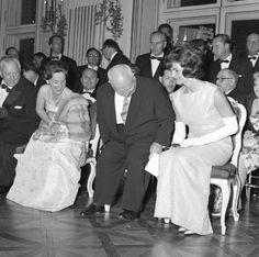 Soviet Premier Nikita Khrushchev takes his seat next to Jacqueline Kennedy, in Vienna, during June 1961 Summit.