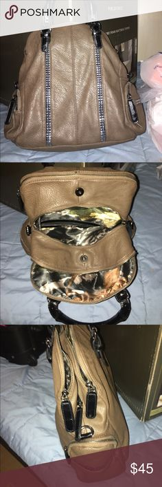 Big Buddha tote Big Buddha brown tote bag with 3 main compartments and side bags all with zippers, very clean inside and out,  and al zippers working, satin like camo interiors, very cute, an every day bag Big Buddha Bags Hobos